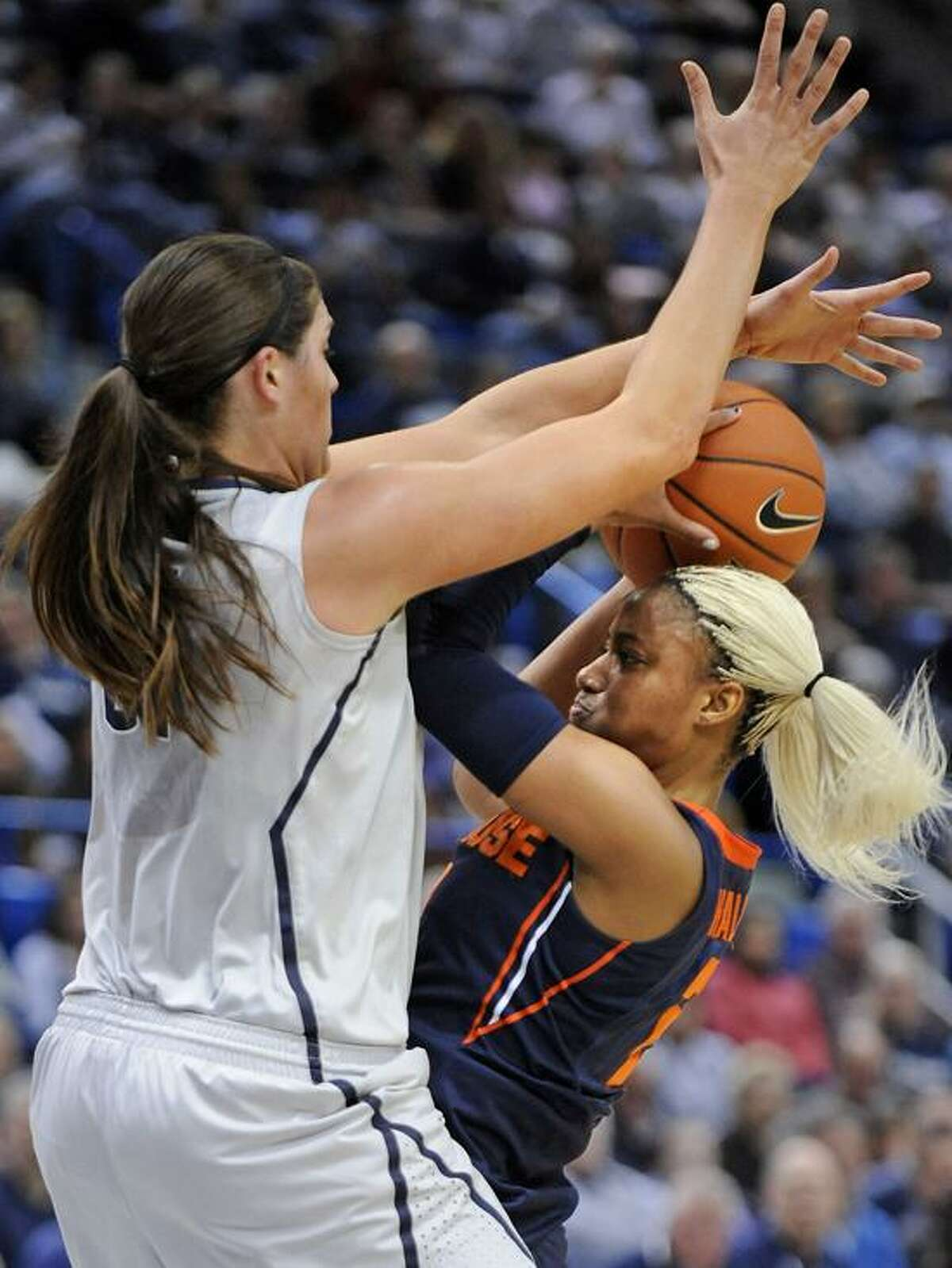 Connecticut's Stefanie Dolson, left, covers Syracuse's Elashier Hall during the second half of an NCAA college basketball game in Hartford, Conn., Saturday, Jan. 19, 2013. Dolson scored a game-high 25 points in Connecticut's 87-62 victory. (AP Photo/Fred Beckham)