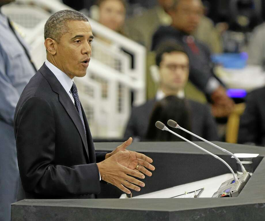 U.S. President Barack Obama speaks during the 68th session of the General Assembly at United Nations headquarters in New York, Tuesday, Sept. 24, 2013. (AP Photo/Seth Wenig) Photo: AP / AP