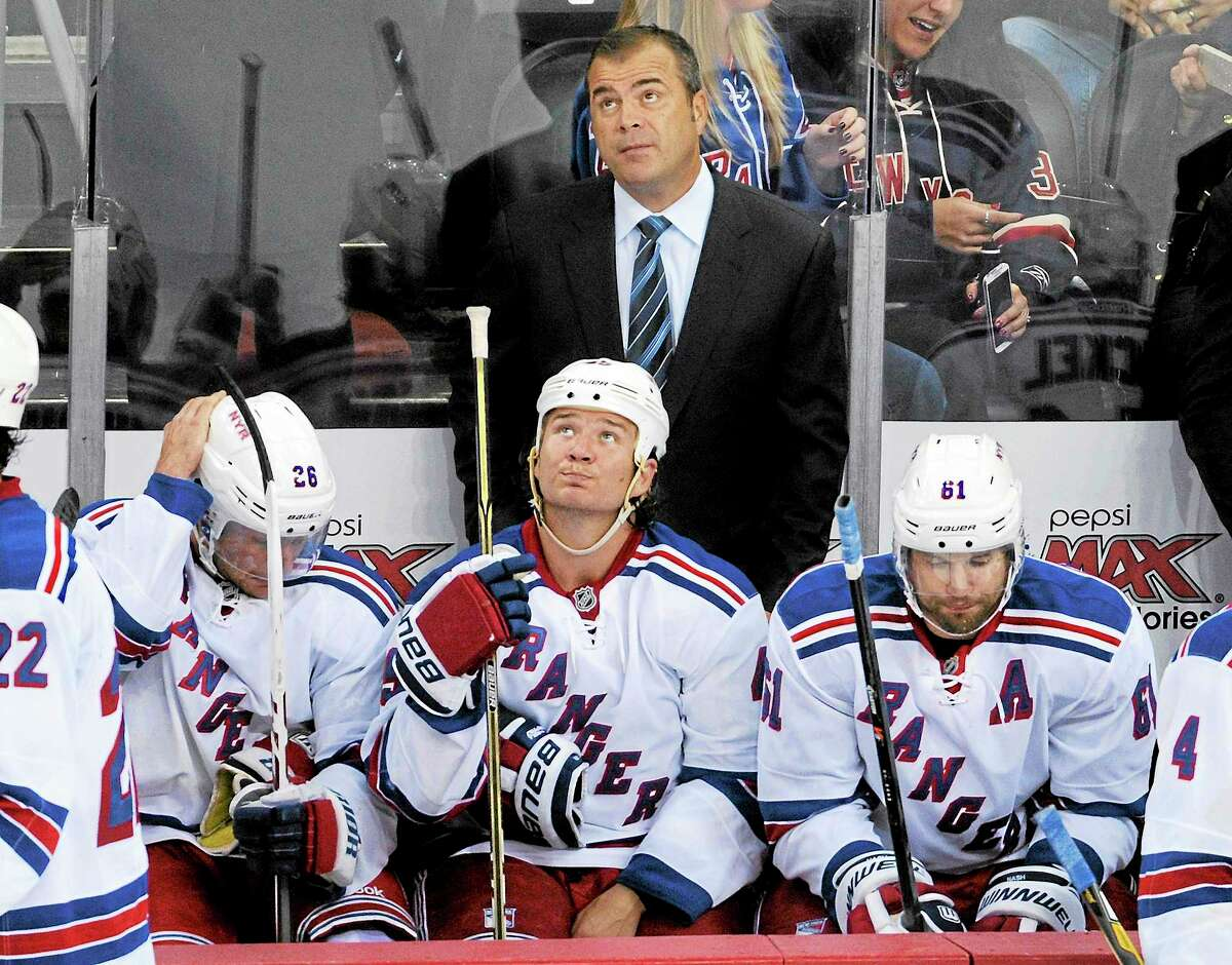 New York Rangers coach Alain Vigneault looks up at the scoreboard during the third period of a preseason game against the Devils on Sept. 16 in Newark, N.J.