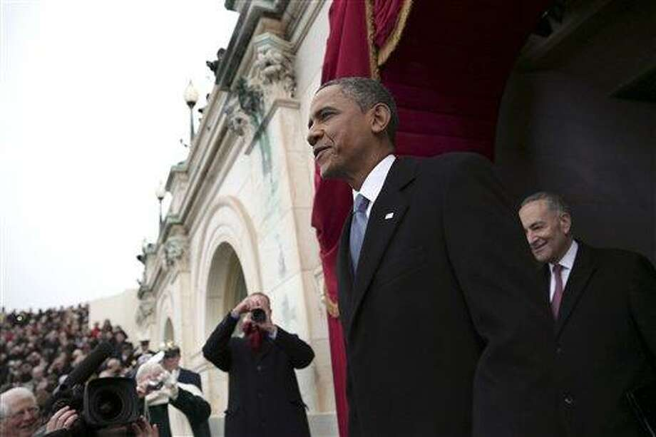 President Barack Obama, followed by Sen. Charles Schumer, D-N.Y., chairman of the Joint Congressional Committee on Inaugural Ceremonies, arrives on the West Front of the Capitol in Washington, Monday, Jan. 21, 2013, for his ceremonial swearing-in ceremony during the 57th Presidential Inauguration.  (AP Photo/Win McNamee, Pool) Photo: AP / Pool Getty Images North America