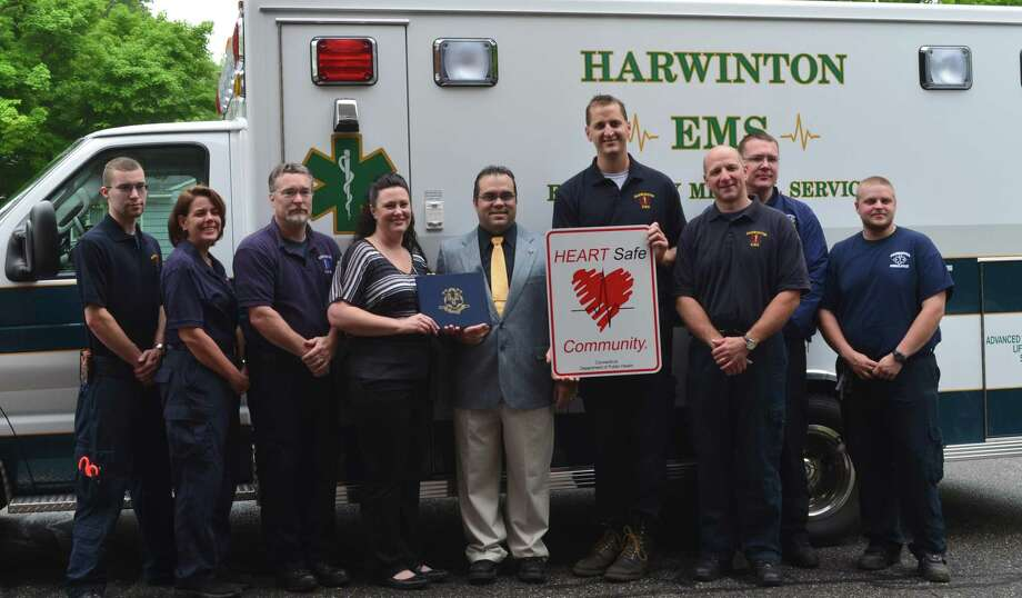 Members of Harwinton Ambulance/EMS receiving the HEARTSafe designation for Harwinton on their 50th anniversary. (Left to right); Ray Wheeler; Wendy Wheeler;  Vinnie Wheeler, Captain;  Michele Connelly, Regional EMS Coordinator for State of CT Dept. of Public Health; Michael Criss, First Selectman for Harwinton; Kevin Ferrarotti, Deputy Chief; Jason Emery, Chief; Jacob Keller and Tyler Reginatto. (Photo by Jenny Golfin/Register Citizen)