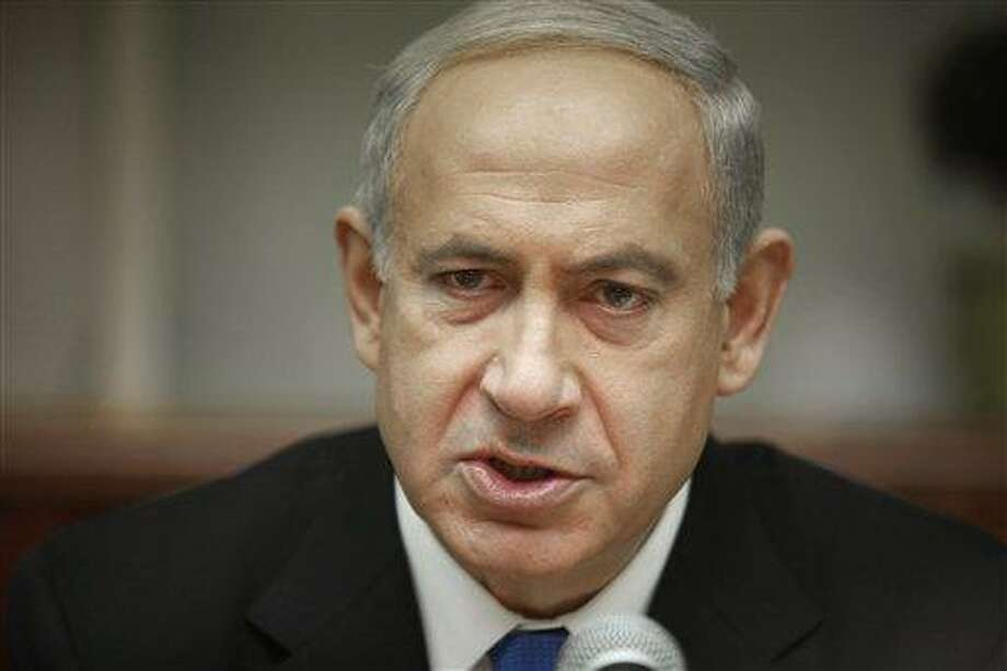 Israeli Prime Minister Benjamin Netanyahu attends the weekly cabinet meeting in Jerusalem Sunday, Jan. 20, 2013. Netanyahu chaired the last meeting of his government, two days before general elections expected to grant him another term. (AP Photo/Gali Tibbon, Pool) Photo: ASSOCIATED PRESS / AP2013