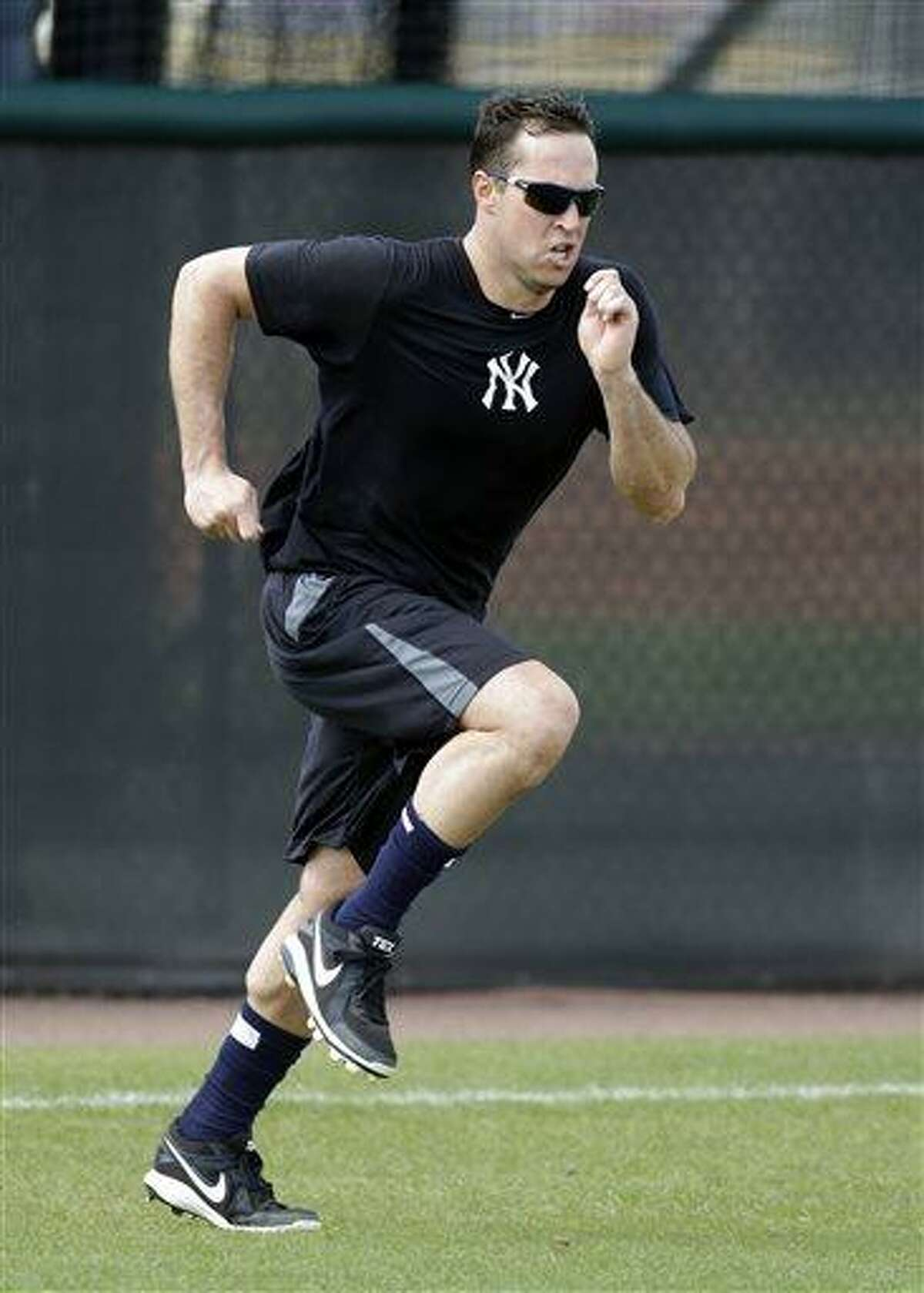 New York Yankees first baseman Mark Teixeira runs sprints during a rehab workout at the Yankees' Minor League complex Monday, May 6, 2013, in Tampa, Fla. Teixeira is making progress towards his return from a wrist injury. (AP Photo/Chris O'Meara)