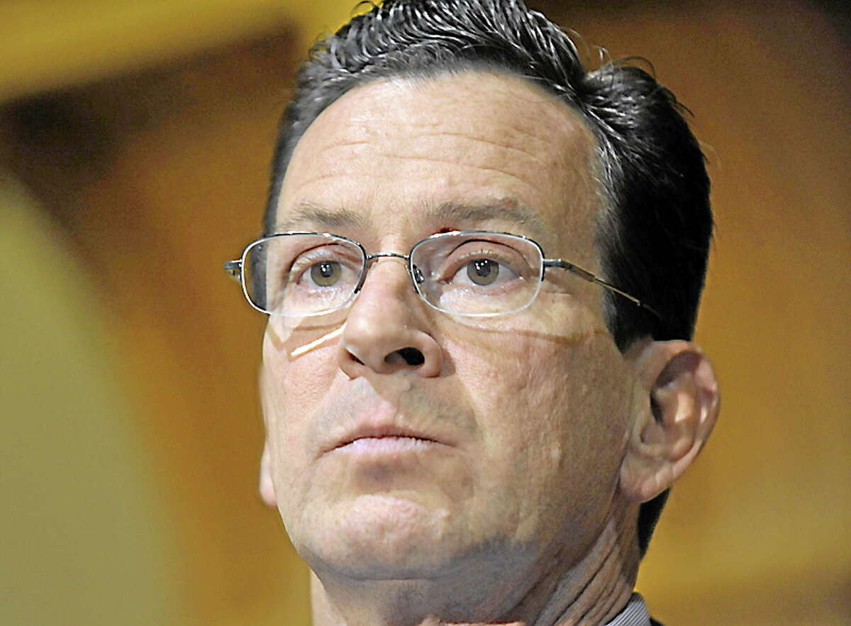 FILE - In this Nov. 8, 2010 file photo, Dan Malloy, who won the Connecticut governor's race, speaks to the media at the Capitol in Hartford, Conn. Twenty-six states elected new governors last month _ 17 Republicans, 8 Democrats and one independent _ and now they are going to have to reconcile their principles and campaign promises with some harsh fiscal realities. Malloy, the former Stamford mayor, said he will have to raise taxes and cut services to close a projected $3.5 billion shortfall, one of the largest of any state as a percentage of its overall budget. (AP Photo/Jessica Hill, File)