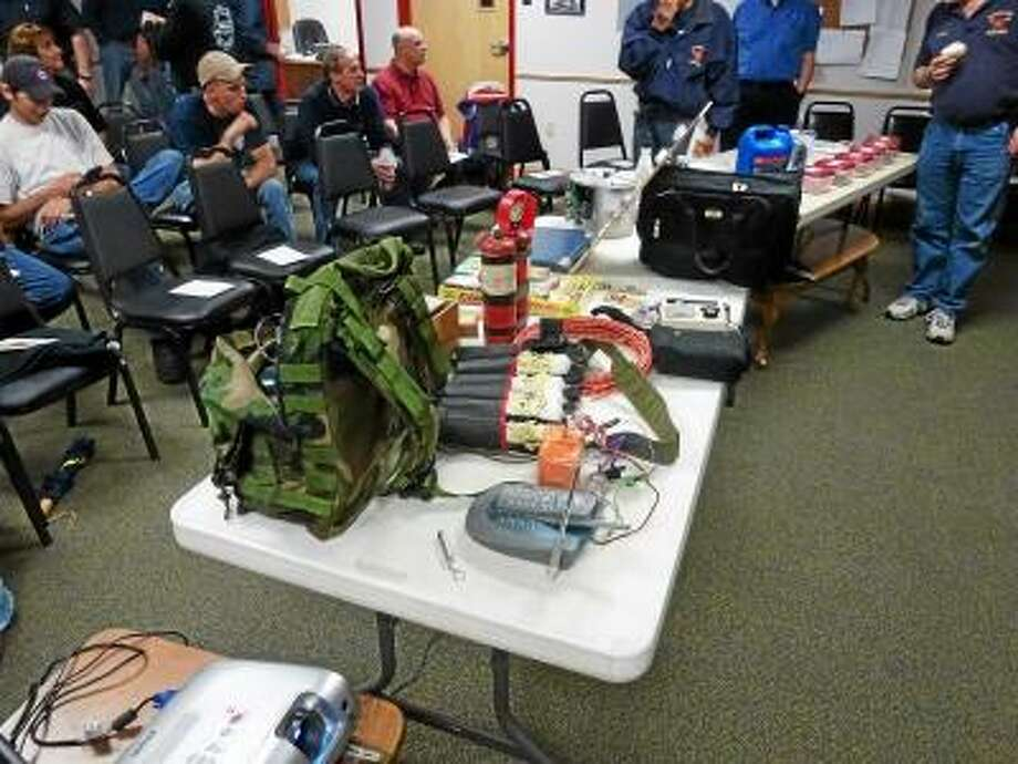 Ryan Flynn/Register Citizen - Examples of easily and cheaply made explosive devices that Johnson presented to the group.