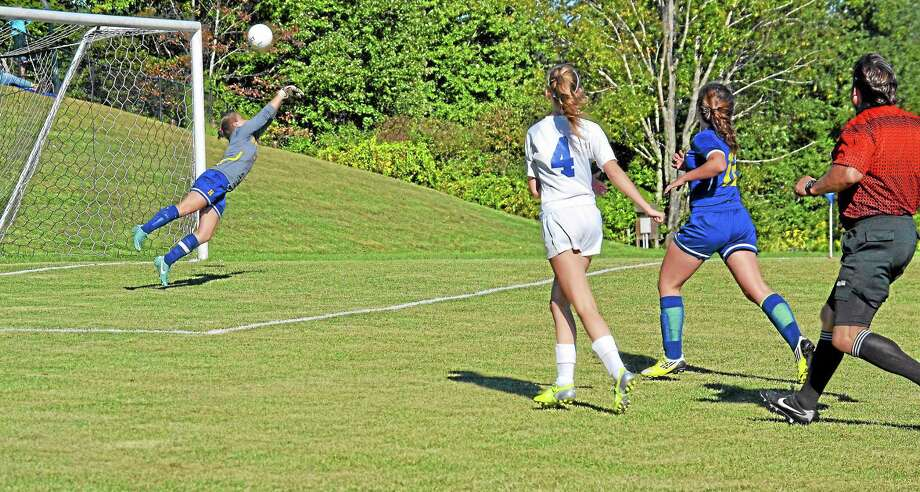 Housatonic's goalie Jill Cannon makes a diving save in the Mountaineers 4-1 win over Litchfield. Photo: Pete Paguaga — Register Citizen