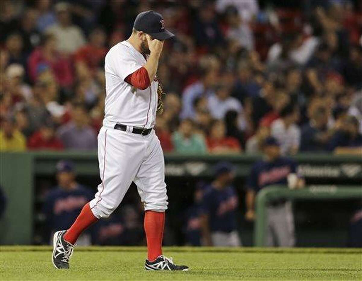 Boston Red Sox relief pitcher Alex Wilson walks back to the mound after giving up a two-RBI triple to Cleveland Indians' Drew Stubbs during the sixth inning of a baseball game at Fenway Park in Boston, Thursday, May 23, 2013. (AP Photo/Charles Krupa)