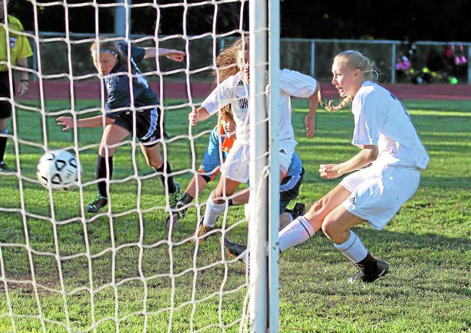 Paige Middleton scores her second goal in the Lady Raider's 2-1 win over Ansonia. Photo: Marianne Killackey — Special To The Register Citizen  / 2013