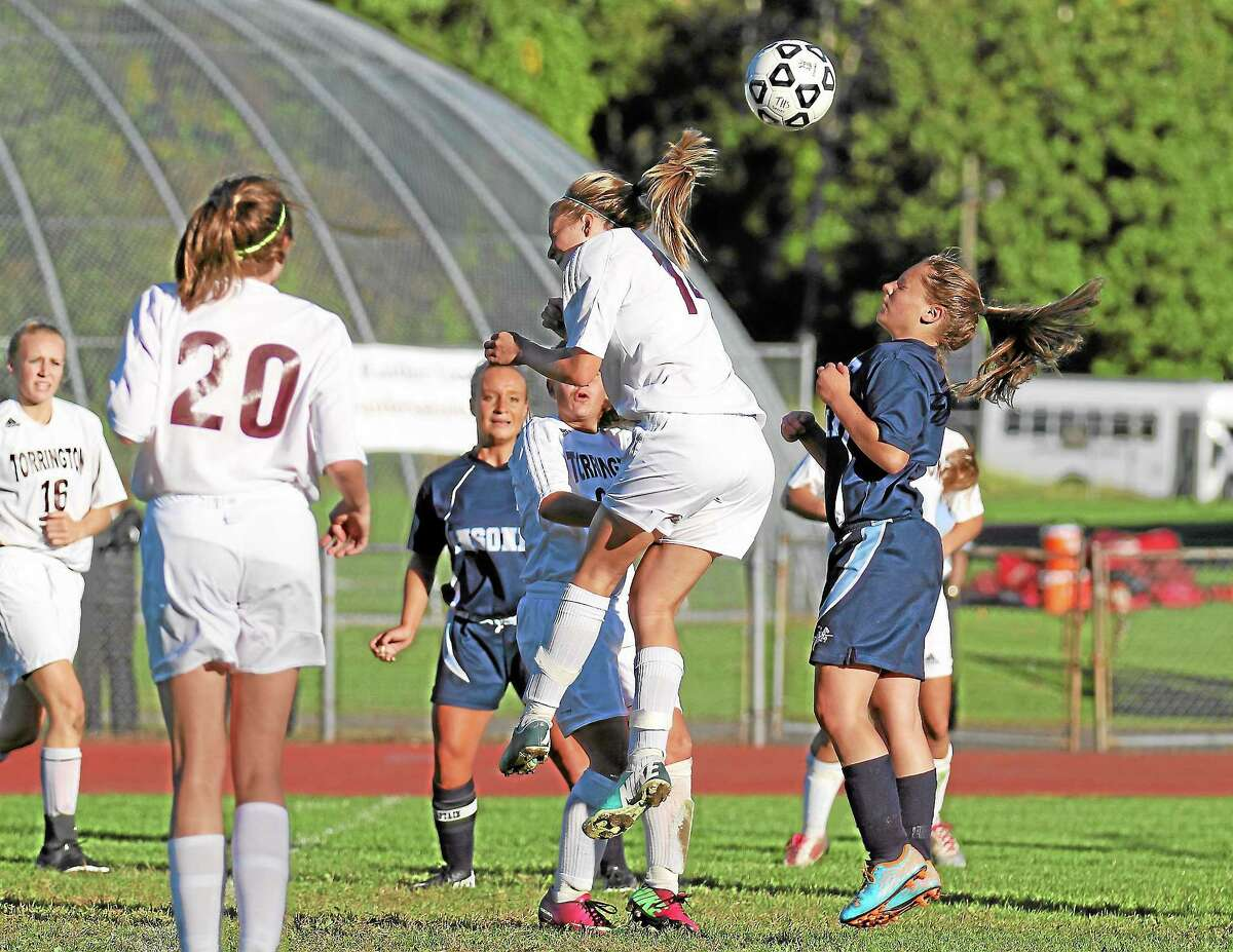 Emily Manchester of the Lady Raiders gets a head on the ball in a goal attempt off a corner kick.