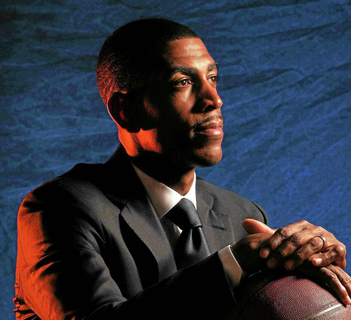 (Peter Hvizdak — New Haven Register) Kevin Ollie is heading into his second season as UConn's men's basketball coach.