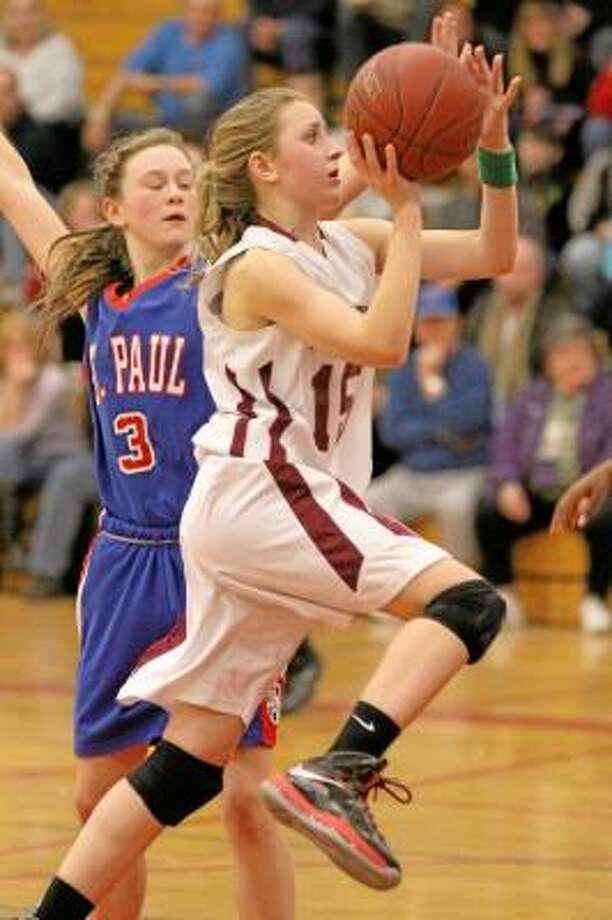Torrington's Caroline Teti drives to the basket against St. Paul Catholic. Photo by Marianne Killackey/Special to Register Citizen / 2013