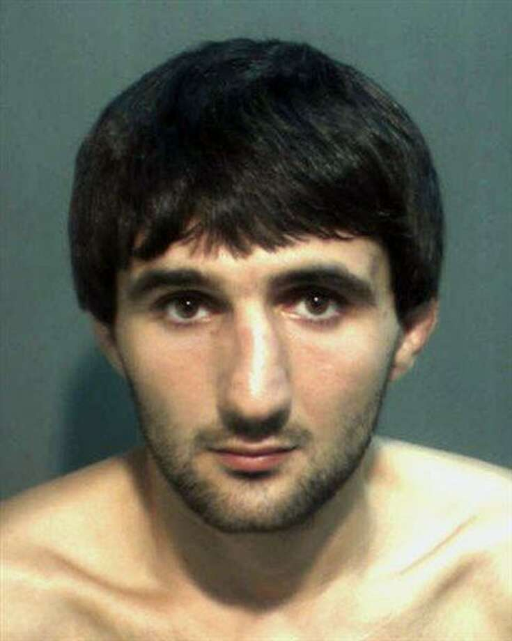 In this May 4, 2013 police mug provided by the Orange County Corrections Department in Orlando, Fla., shows Ibragim Todashev after his arrest for aggravated battery in Orlando. Todashev, who was being questioned in Orlando by authorities in the Boston bombing probe, was fatally shot Wednesday, May 22, 2013 when he initiated a violent confrontation, FBI officials said. (AP Photo/Orange County Corrections Department) Photo: ASSOCIATED PRESS / AP2013