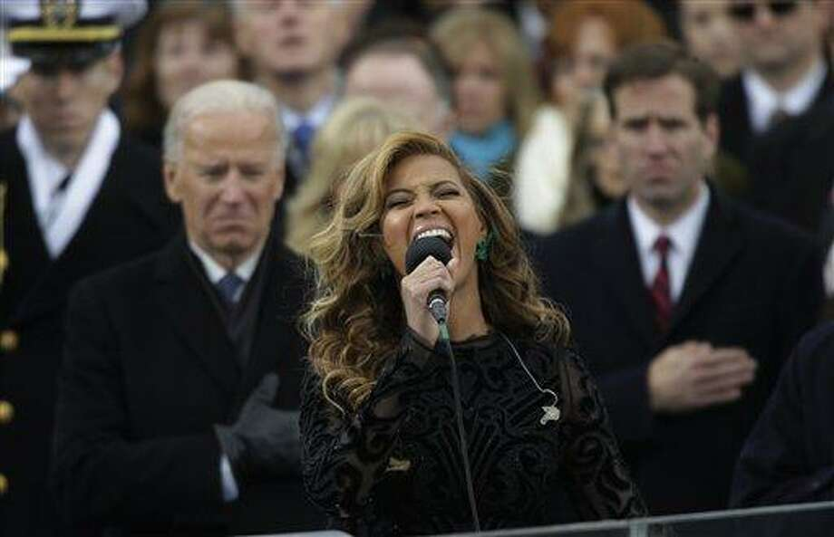 Beyonce sings the national anthem at the ceremonial swearing-in at the U.S. Capitol during the 57th Presidential Inauguration in Washington, Monday, Jan. 21, 2013. (AP Photo/Pablo Martinez Monsivais) Photo: ASSOCIATED PRESS / AP2013