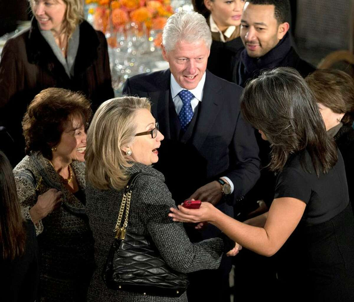 State Secretary Hillary Rodham Clinton, center, and former President Bill Clinton, greet guests at a luncheon after the ceremonial swearing-in of President Barack Obama and Vice President Joe Biden on Capitol Hill in Washington, Monday, Jan. 21, 2013. (AP Photo/Manuel Balce Ceneta)