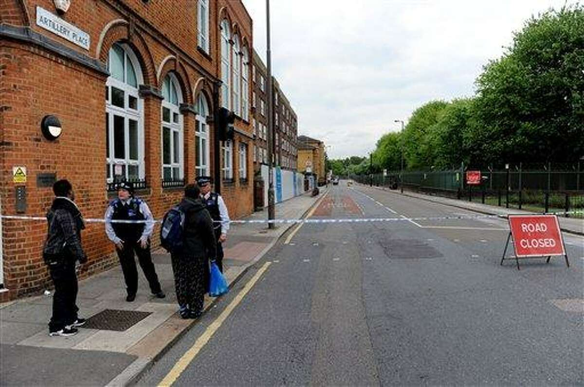 Artillery Place road is closed in Woolwich southeast London near the scene where British officials said one person has died and at least two people have been wounded in an attack on Wednesday May 22, 2013. (AP Photo/Nick Ansell/PA) UNITED KINGDOM OUT NO SALES NO ARCHIVE