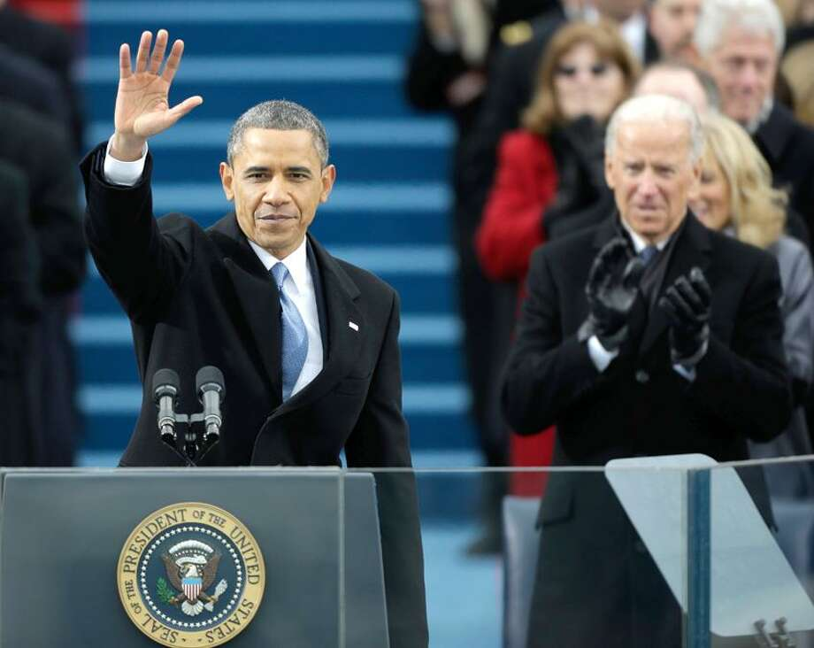 President Barack Obama waves after his speech while Vice President Joe Biden applauds at the ceremonial swearing-in at the U.S. Capitol during the 57th Presidential Inauguration in Washington, Monday, Jan. 21, 2013. (AP Photo/Pablo Martinez Monsivais) Photo: ASSOCIATED PRESS / AP2013