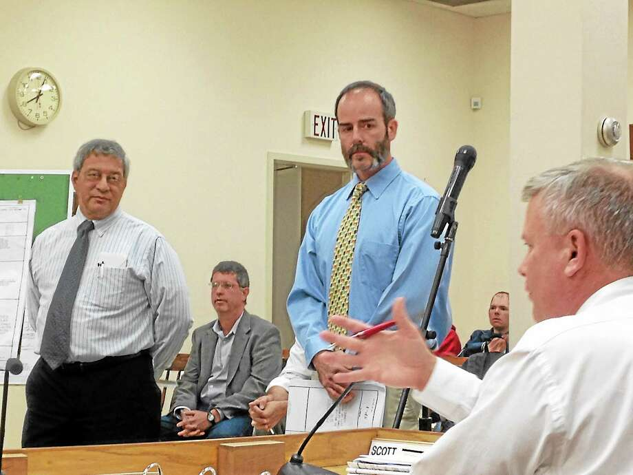 Town Manager Dale Martin tells Selectmen Mike Renzullo that his application will be denied during a meeting of the Winsted Planning and Zoning Commission Monday. Photo: Mercy Quaye—Register Citizen