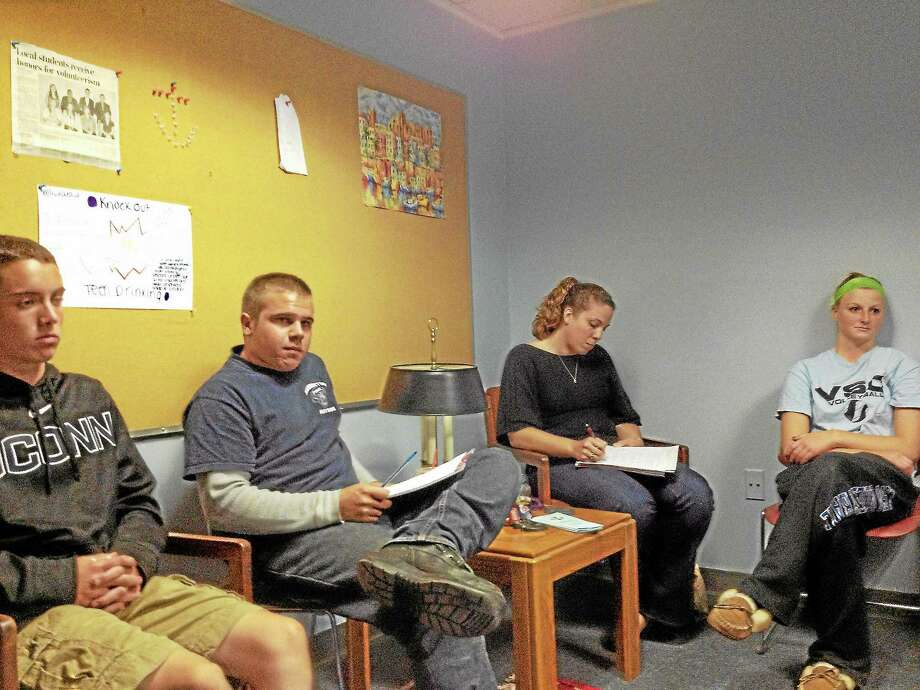 Members of Safe Harbor Youth Services met to plan their Tips for Teens Fundraiser set for this Friday from 6 to 9 p.m. Photo: Kate Hartman—Register Citizen