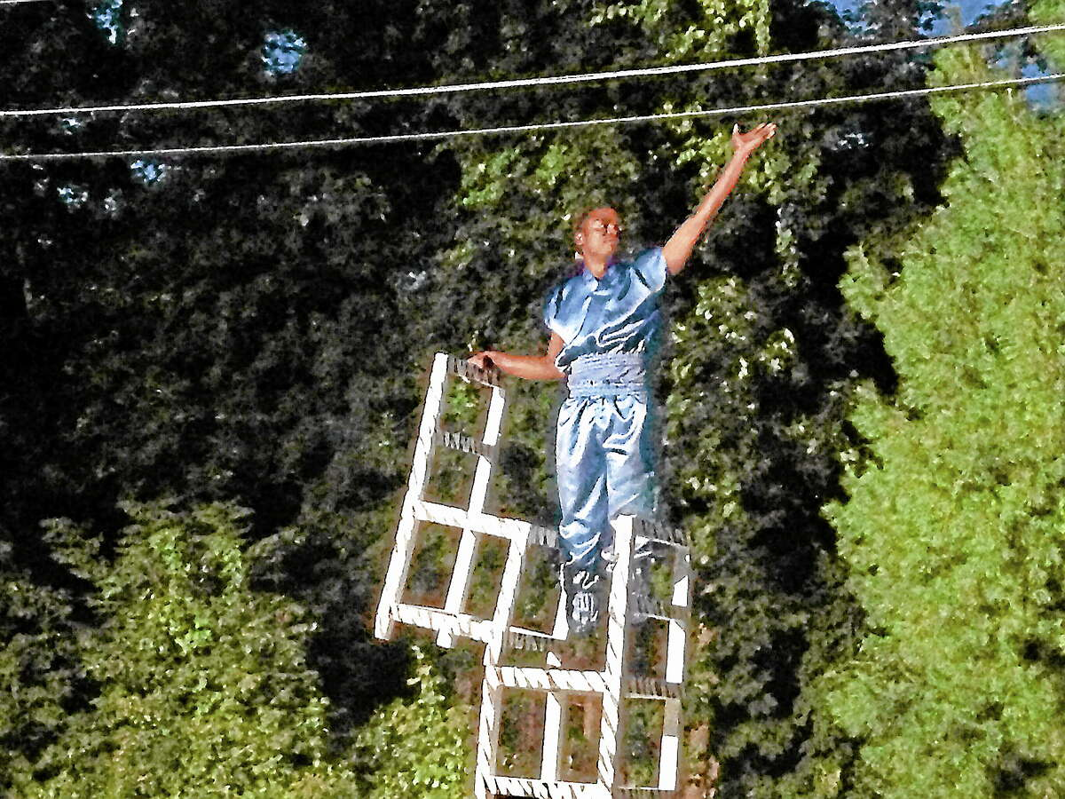 A member of the Jabali African Acrobats performs during a celebration of the Jewish Sukkot at Litchfield's Chabad Lubavitch synagogue Monday.