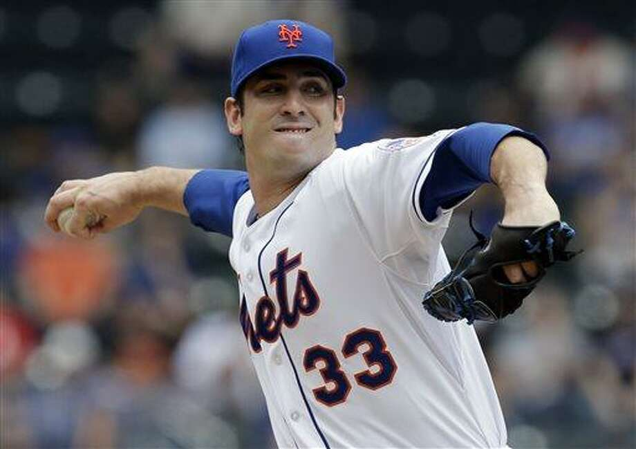 New York Mets starting pitcher Matt Harvey pitches during the first inning of the baseball game against the Cincinnati Reds at Citi Field Wednesday, May 22, 2013 in New York. (AP Photo/Seth Wenig) Photo: AP / AP