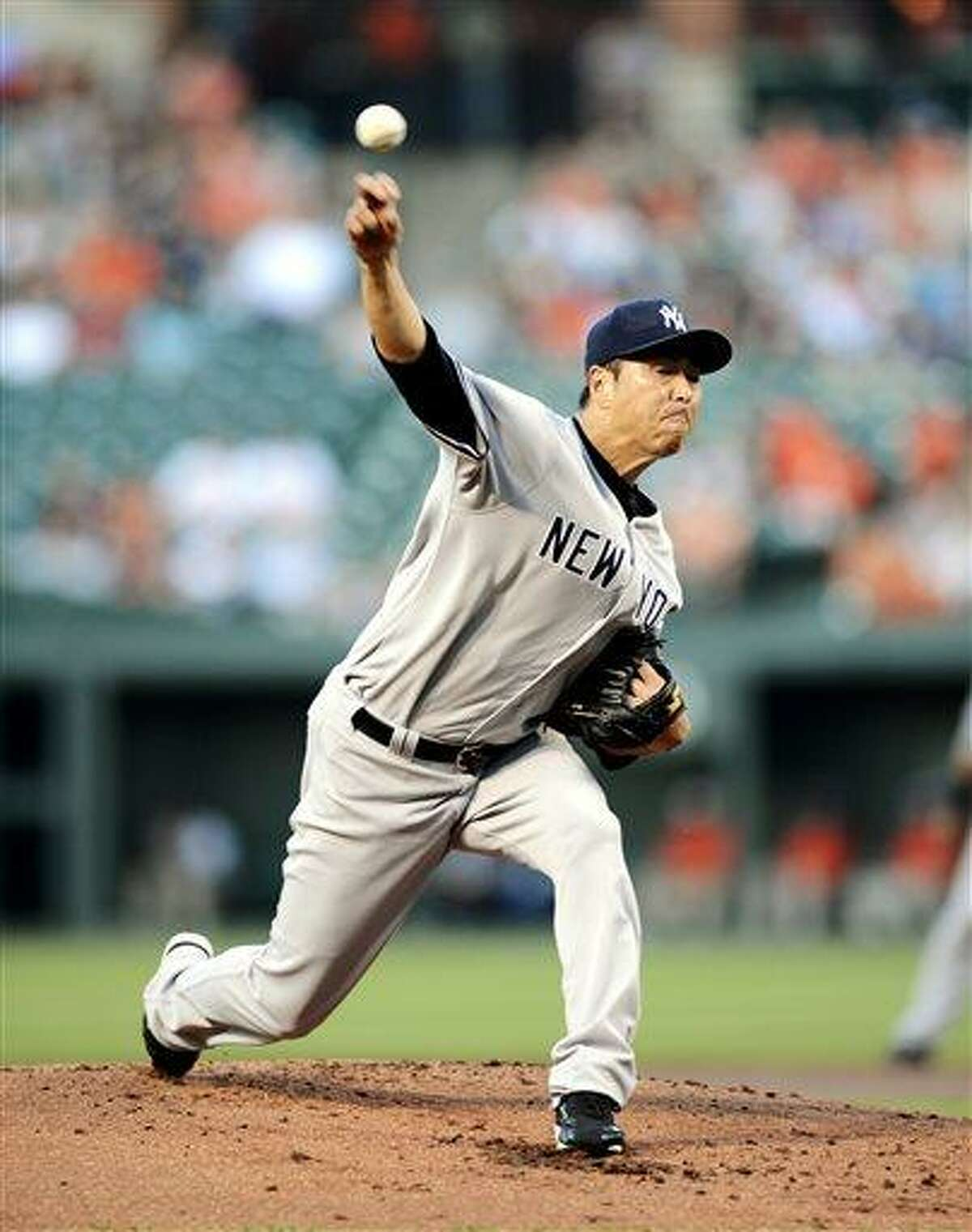 New York Yankees starting pitcher Hiroki Kuroda, of Japan, delivers against the Baltimore Orioles during the first inning of a baseball game, Wednesday, May 22, 2013, in Baltimore. (AP Photo/Nick Wass)