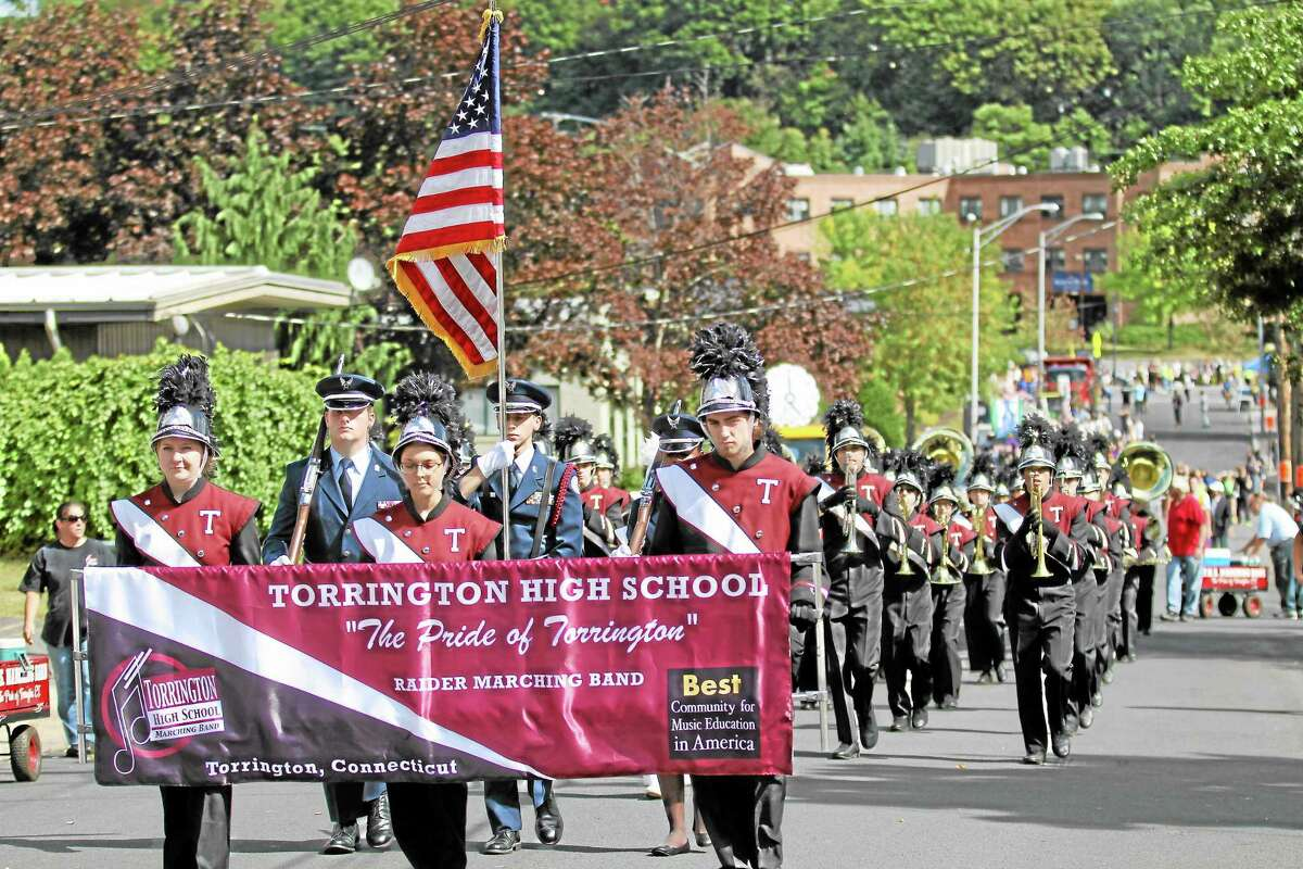 The Pride of Torrington marching band prepares to step off at the Bristol Mum Parade on a beautiful fall Sunday afternoon.