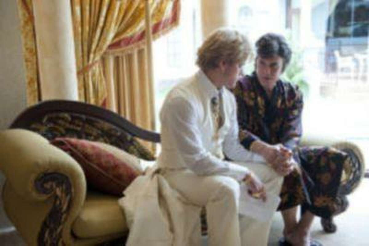 """Michael Douglas, right, as Liberace, and Matt Damon, as Scott Thorson, in a scene from """"Behind the Candalabra,"""" a film being shown at the Cannes Film Festival. (AP Photo/HBO, Claudette Barius)"""
