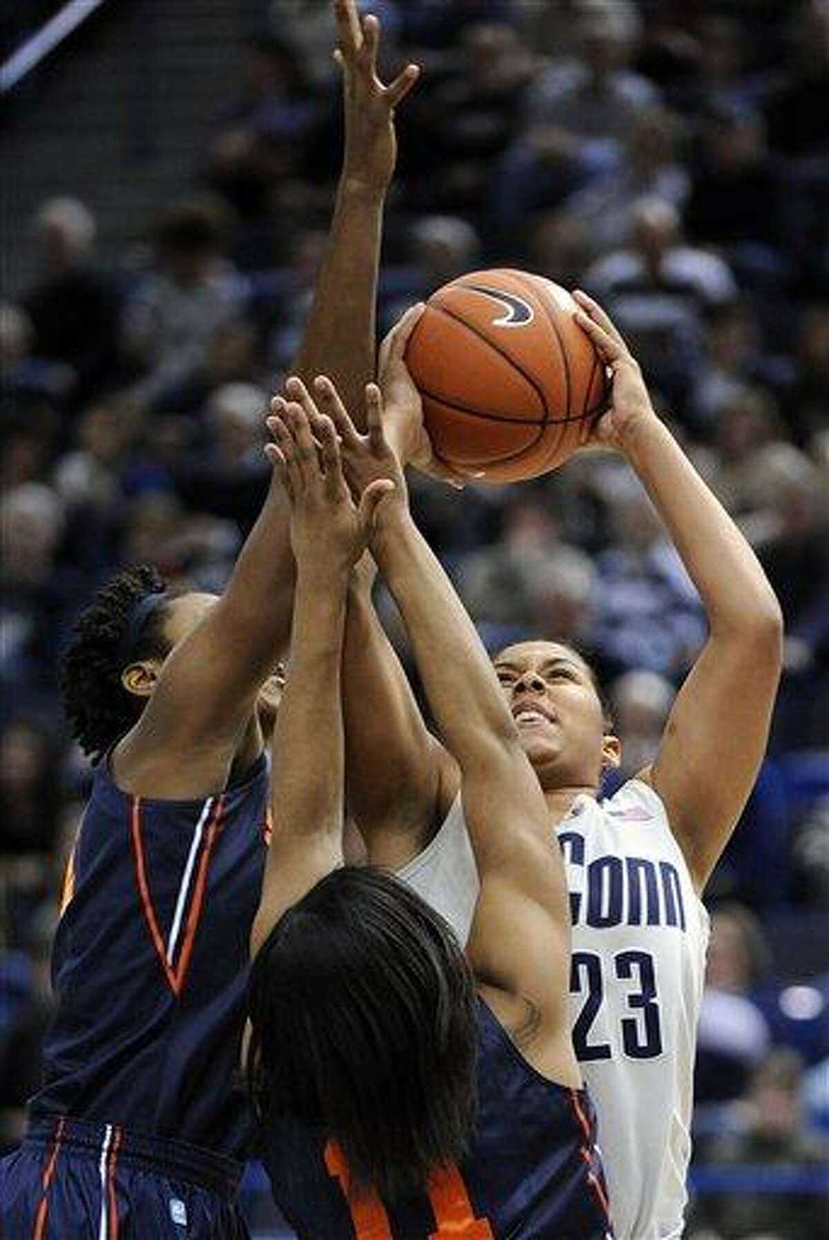 Connecticut's Kaleena Mosqueda-Lewis, right, is guarded by Syracuse's Kayla Alexander, left, and Cornelia Foundren during the first half of an NCAA college basketball game in Hartford, Conn., Saturday, Jan. 19, 2013. (AP Photo/Fred Beckham)