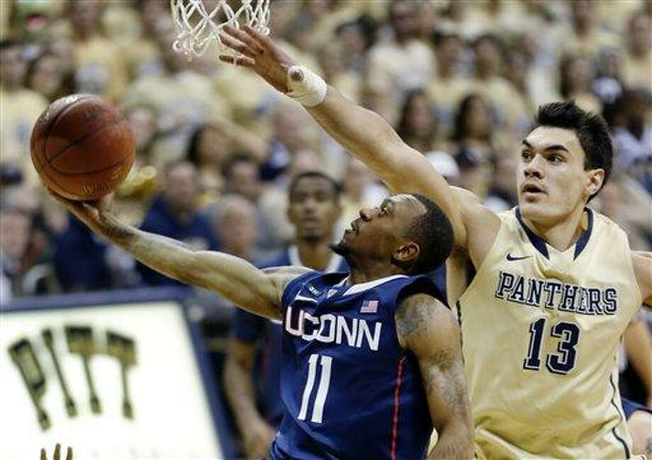 Connecticut's Ryan Boatright (11) shoots as he gets behind Pittsburgh's Steven Adams (13) during the second half of an NCAA college basketball game, Saturday, Jan. 19, 2013, in Pittsburgh. Pittsburgh won 69-61. (AP Photo/Keith Srakocic) Photo: ASSOCIATED PRESS / AP2013