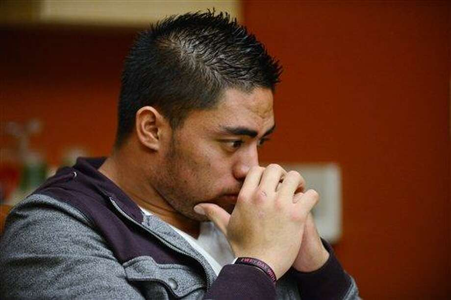 """In a photo provided by ESPN, Notre Dame linebacker Manti Te'o pauses during an interview with ESPN on Friday, Jan. 18, 2013, in Bradenton, Fla. ESPN says Te'o maintains he was never involved in creating the dead girlfriend hoax. He said in the off-camera interview: """"When they hear the facts they'll know. They'll know there is no way I could be a part of this."""" (AP Photo/ESPN Images, Ryan Jones) Photo: ASSOCIATED PRESS / ESPN Inc.2013"""