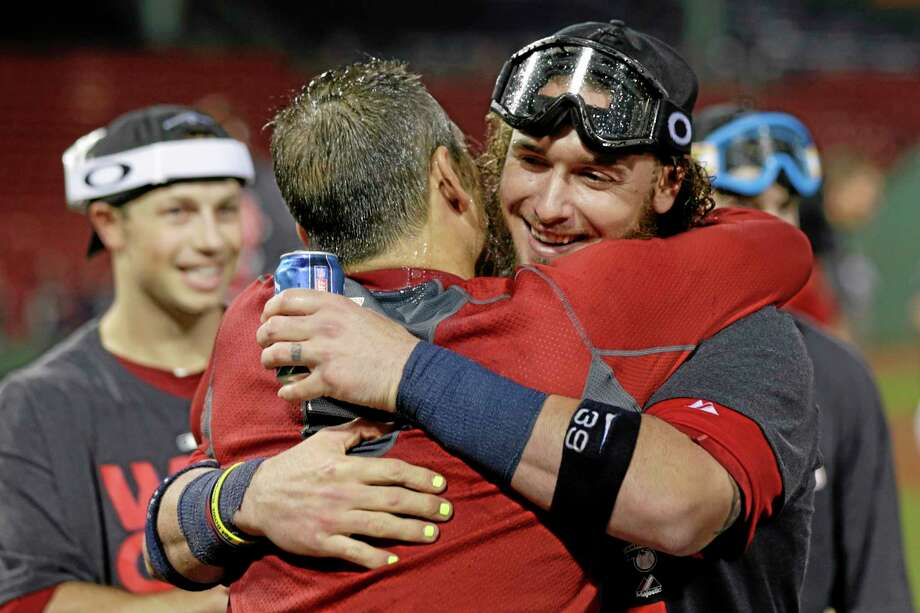 Red Sox catcher Jarrod Saltalamacchia, right, celebrates with teammates after the Sox clinched the AL East title with a 6-3 win over the Toronto Blue Jays on Friday night at Fenway Park in Boston. Photo: Charles Krupa — The Associated Press  / AP