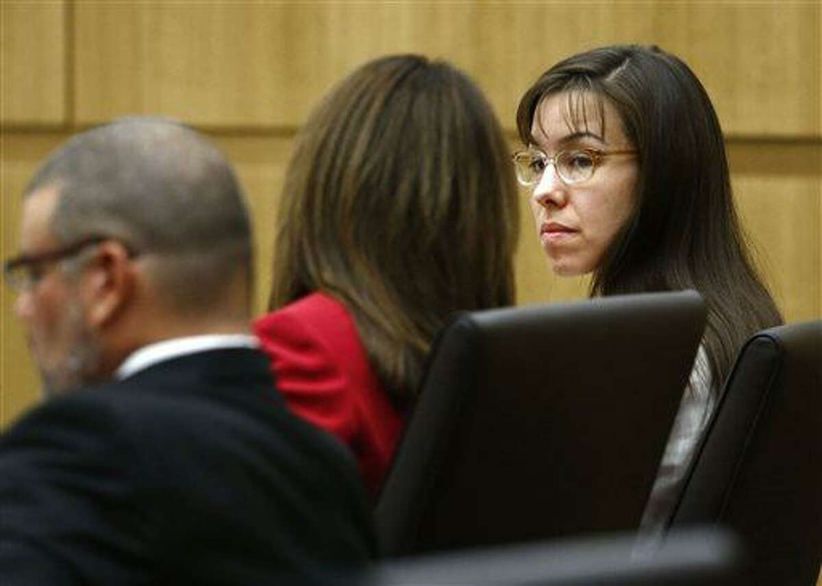 Jodi Arias looks at her defense attorney Jennifer Wilmott on Monday, May 20, 2013 during the penalty phase of Arias' murder trial at Maricopa County Superior Court in Phoenix, AZ. Jodi Arias was convicted of first-degree murder in the stabbing and shooting to death of Travis Alexander, 30, in his suburban Phoenix home in June 2008. (The Arizona Republic, Rob Schumacher, Pool)