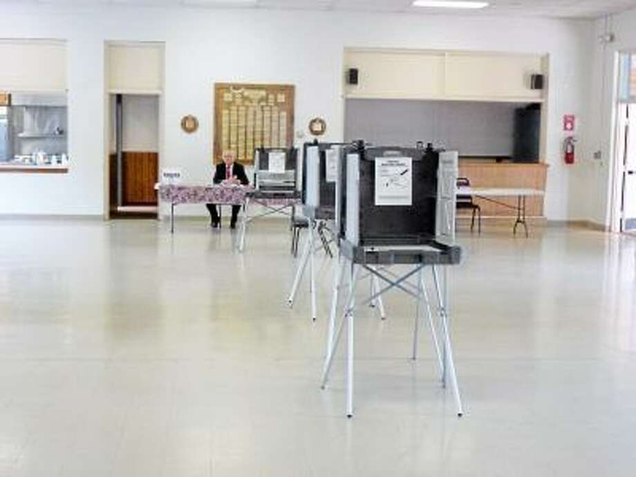 Ryan Flynn/Register Citizen The polls at Litchfield firehouse for the first town referendum in years.