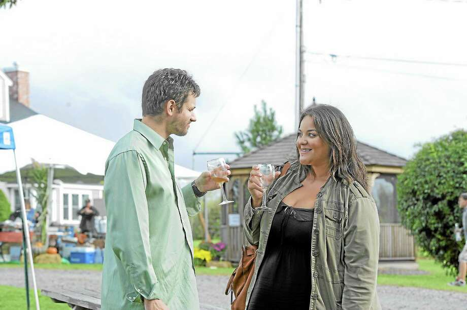 Justin Sherman and Lindsey Butler enjoy wine at the Sunset Meadow Vineyard harvest festival on Saturday in Goshen. Photo: Laurie Gaboardi — Register Citizen