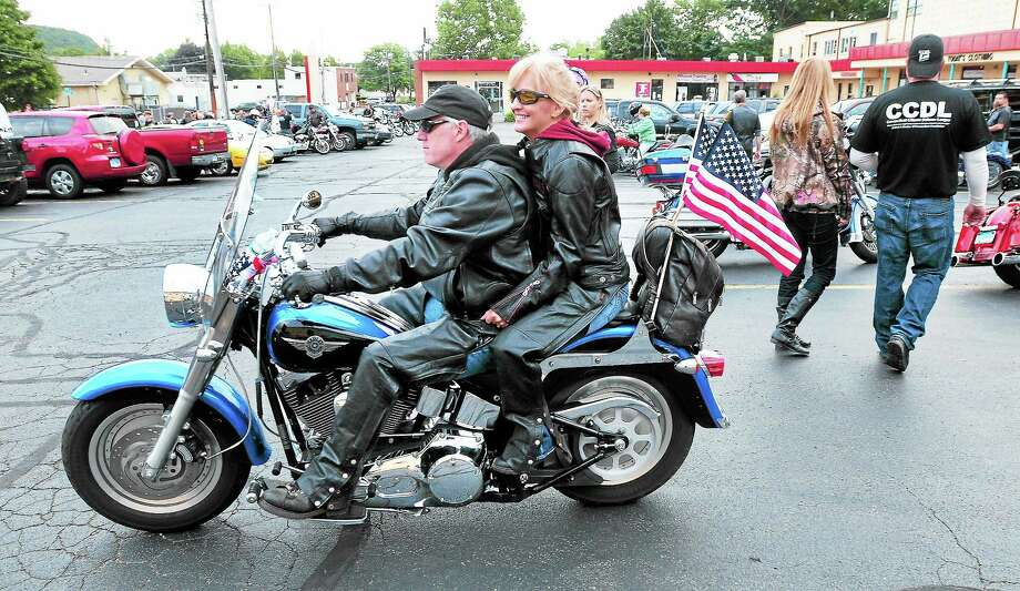 Frank and Kim DiTerlizzi of Naugatuck begin the CCDL's 2nd Amendment Poker Run Saturday in Woodbridge. Photo: Arnold Gold — New Haven Register