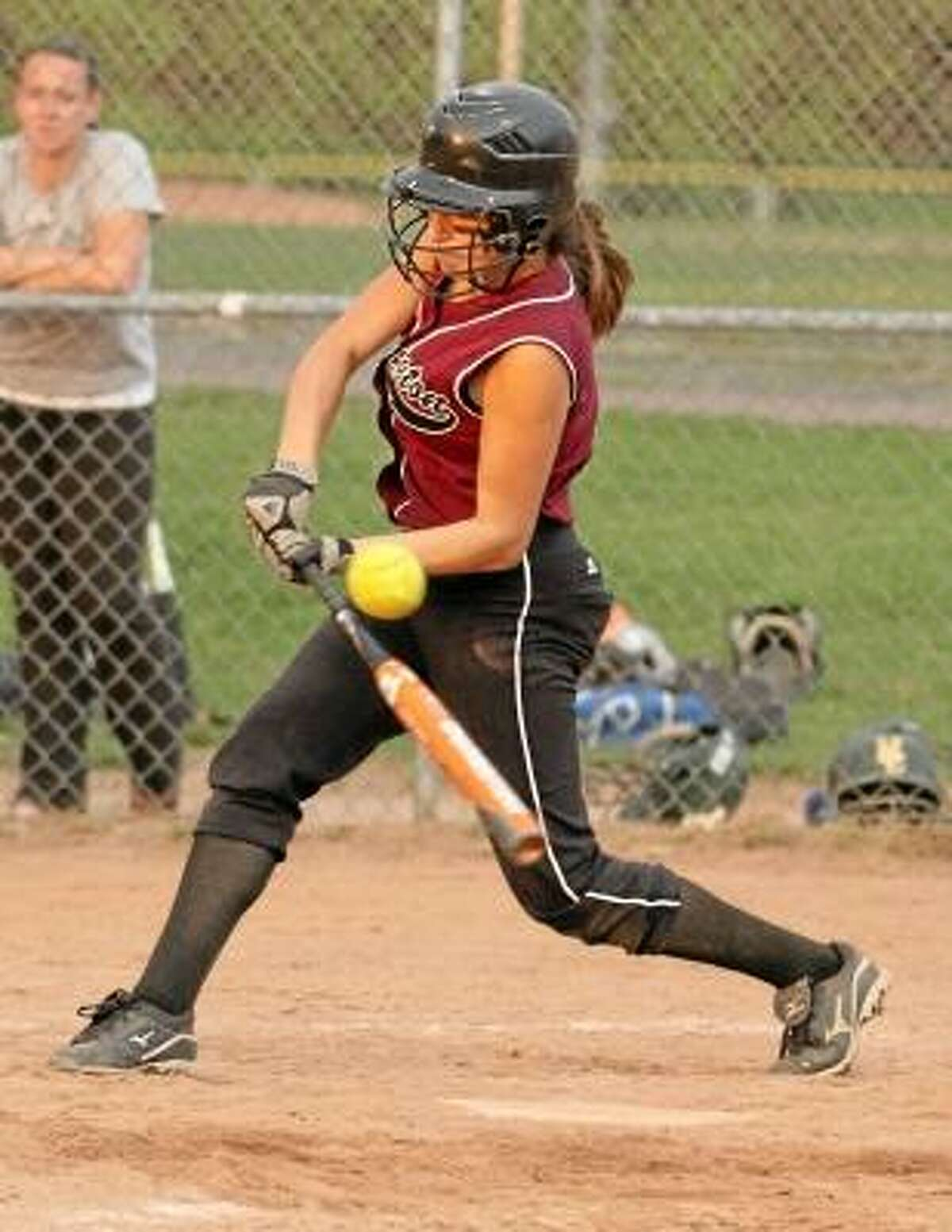 Photo by Marianne Killackey/Special to Register Citizen Torrington's Brittany Young hits a double in the Raiders' 5-1 victory against Holy Cross
