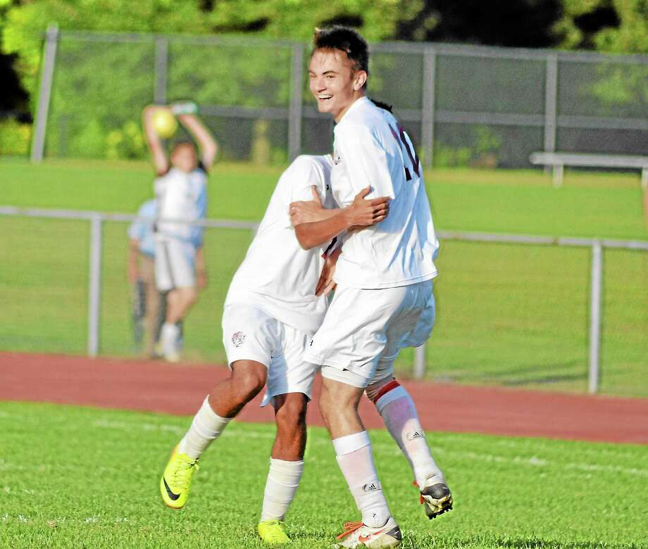 Amar Suljic celebrates with Michael DeSousa after scoring the game-winning goal in Torrington's 1-0 win against Watertown. Photo: Pete Paguaga — Register Citizen