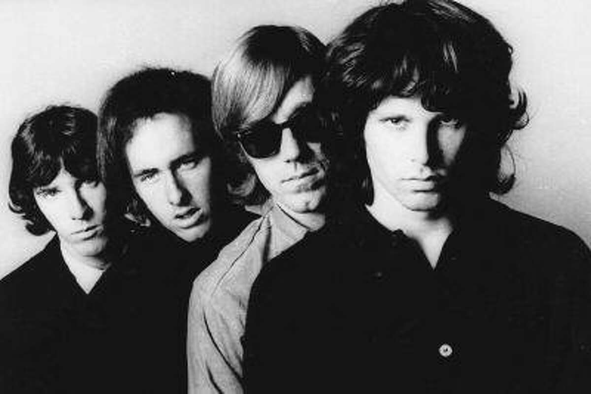 FILE - In this undated publicity file photo, members of the Doors, from left, John Densmore, Robbie Krieger, Ray Manzarek and Jim Morrison, pose for a portrait. Manzarek, the keyboardist who was a founding member of The Doors, has died at 74. Publicist Heidi Robinson-Fitzgerald says in a news release that Manzarek died Monday, May 20, 2013, at the RoMed Clinic in Rosenheim, Germany, surrounded by his family. (AP Photo, File)