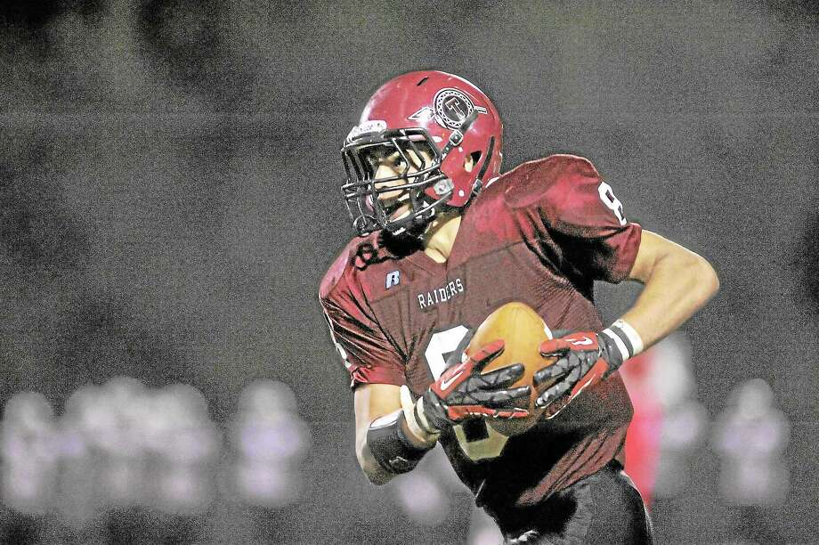 Torrington's Desmond Langs hauls in a 50-yard touchdown pass from Anthony Pandolfo. The Red Raiders lost to Wilby 34-19. Photo: Laurie Gaboardi — Register Citizen
