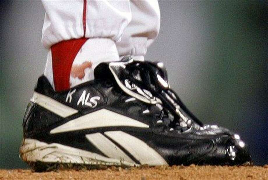FILE - In this Oct. 24, 2004, file photo, blood appears around the right ankle of Boston Red Sox pitcher Curt Schilling during the sixth inning of Game 2 of baseball's World Series against the St. Louis Cardinals in Boston. Schilling, whose video game company underwent a spectacular collapse into bankruptcy last year, is selling the blood-stained sock he wore during that game. (AP Photo/Winslow Townson, File) Photo: ASSOCIATED PRESS / AP2013