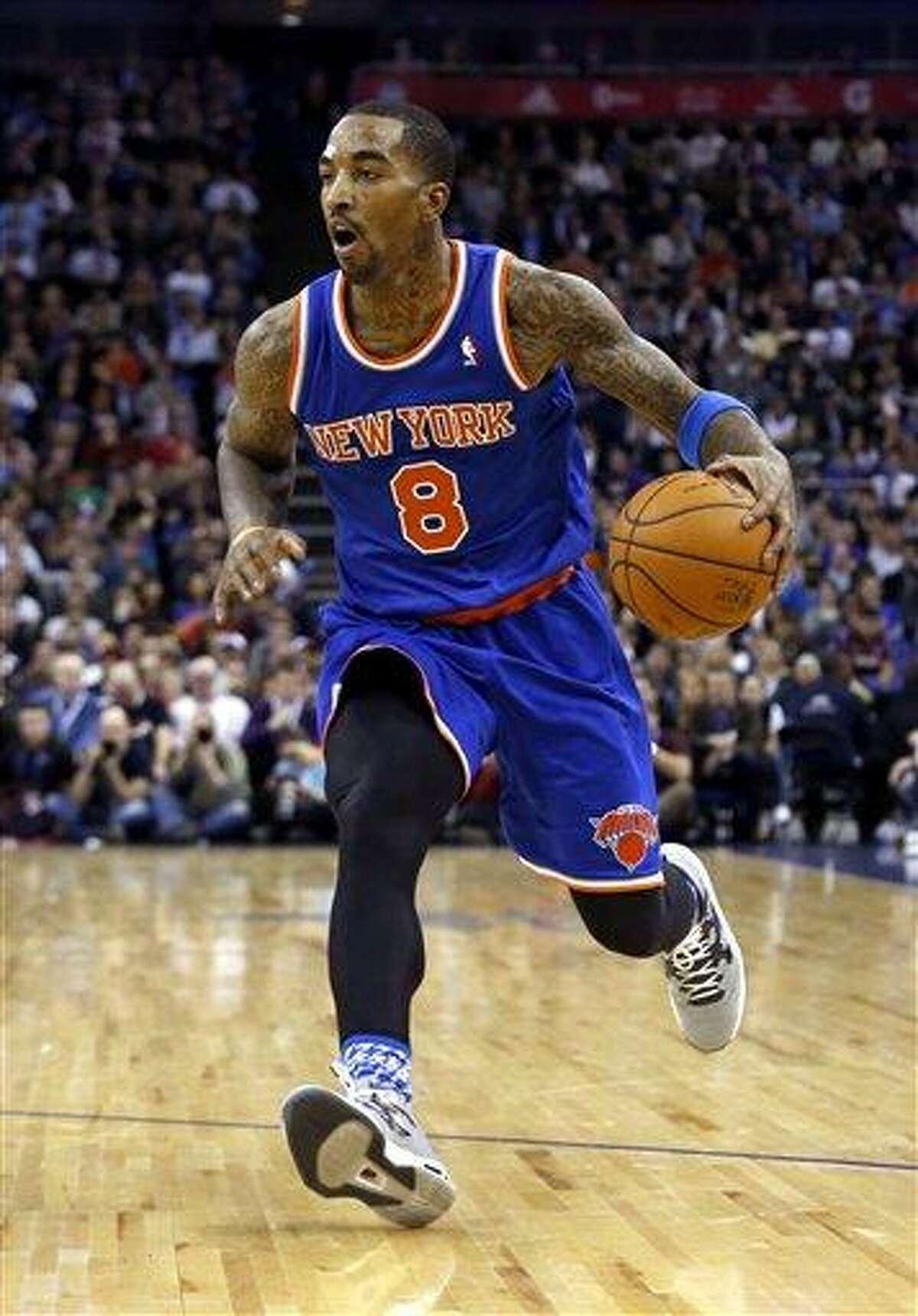 New York Knicks guard J.R. Smith dribbles the ball during their NBA basketball game against Detroit Pistons at the 02 arena in London, Thursday, Jan. 17, 2013. (AP Photo/Matt Dunham)