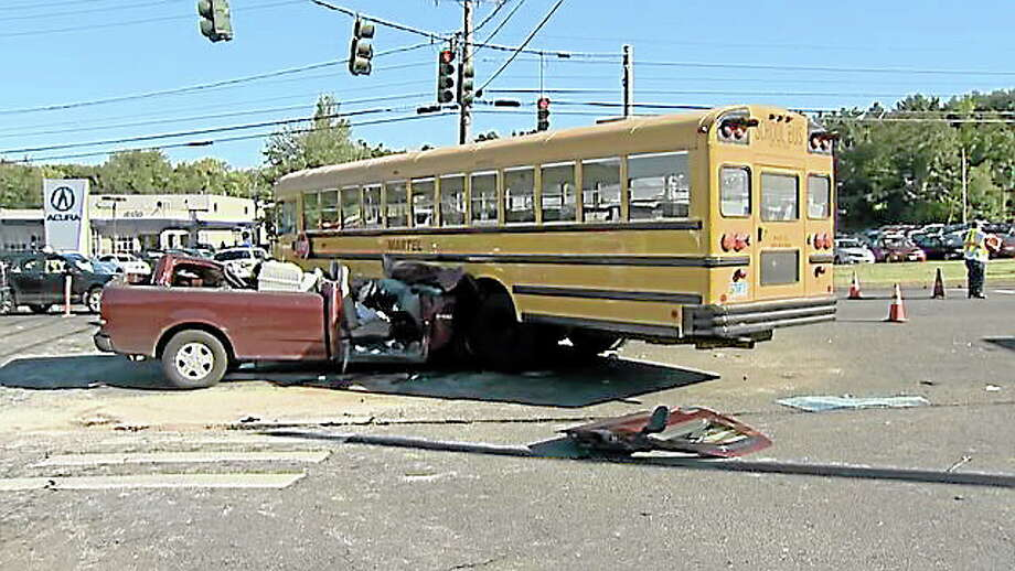 A pickup truck and school bus were involved in an accident on Route 44 in Canton on Friday, Sept. 20, 2013. Photo: WTNH News 8 Photo