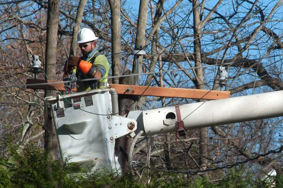 Lineman from Scobee Powerline Construction of Cameron, Mo. (subcontractors for CL&P)  rerigs electrical lines on Long Hill Rd in Guilford November 1, 2012. vm Williams