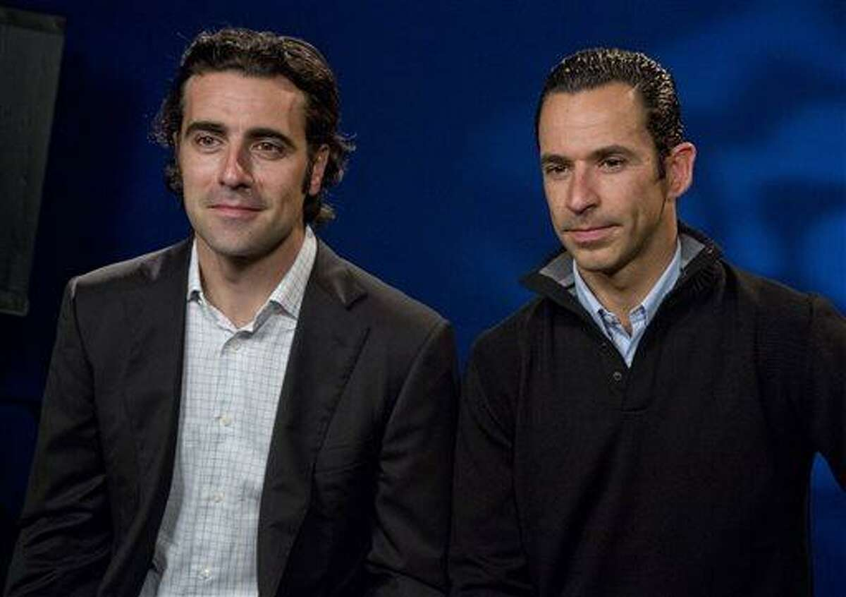 Scotland's Dario Franchitti, left, and Brazil's Helio Castroneves are interviewed, in New York, Monday May 20, 2013. They will try to become the first foreign-born four-time winners in Indianapolis 500 history at Sunday's race. (AP Photo/Richard Drew)