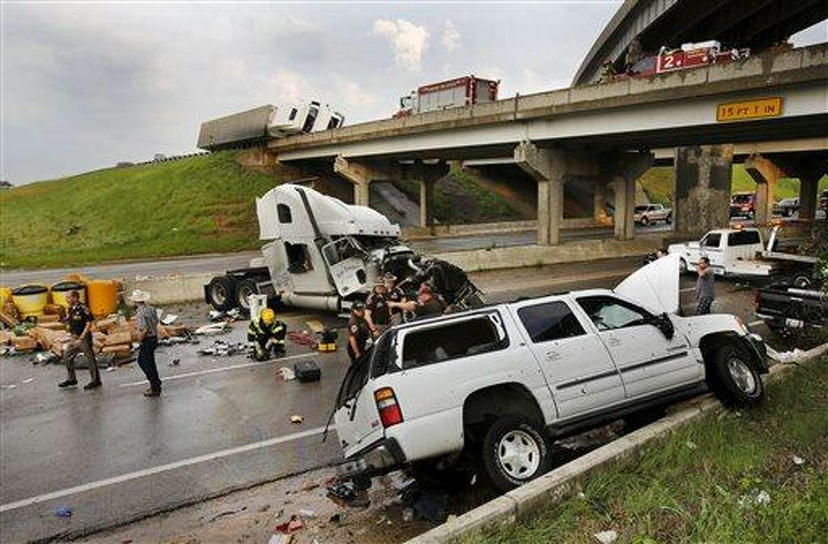 A tornado caused extensive damage along Interstate 40 at the junction with U.S. 177 on the west side of Shawnee, Okla., Sunday evening, May 19, 2013. (AP Photo/The Oklahoman, Jim Beckel)