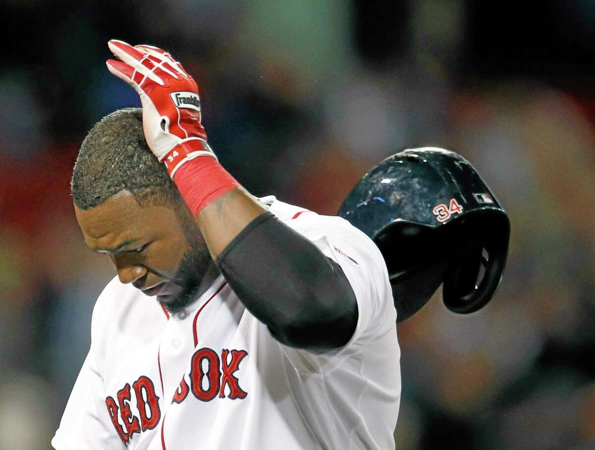 Red Sox designated hitter David Ortiz tosses his helmet after making the last out in a game against the Baltimore Orioles.
