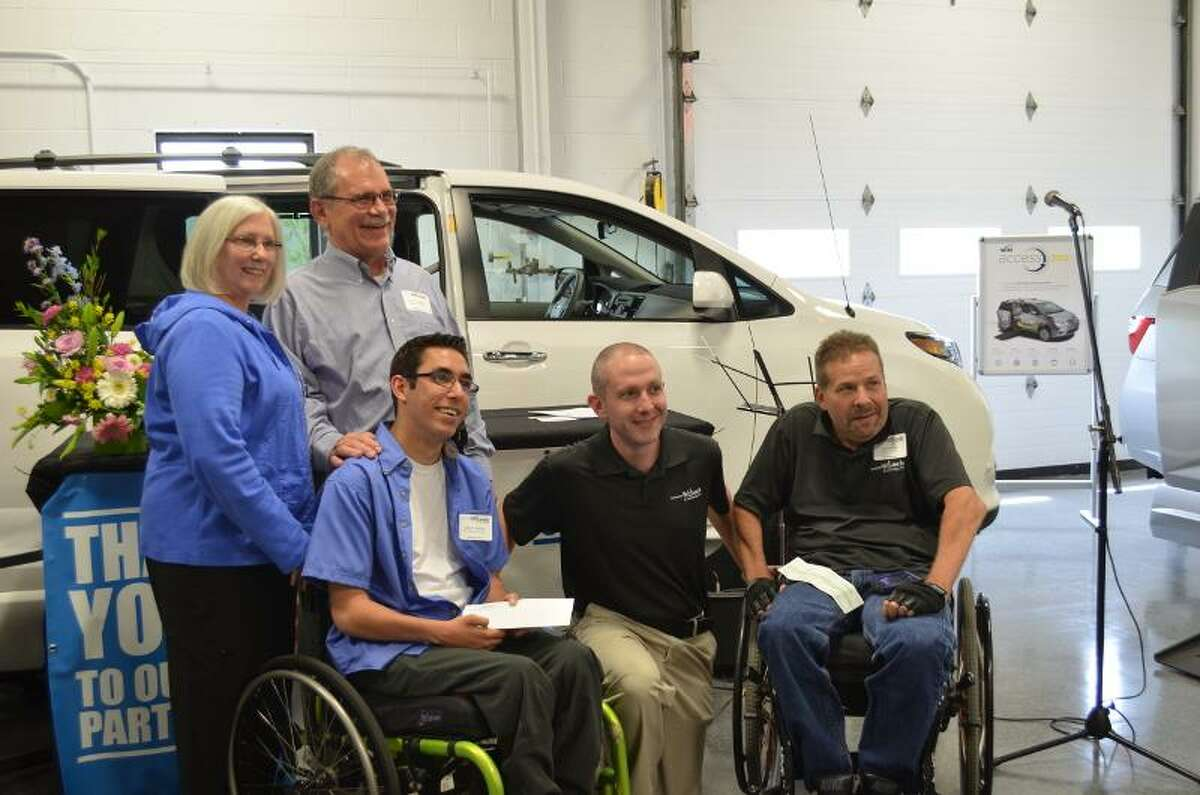Jenny Golfin/Register Citizen - Left to right, Linda Klemba, Joseph Klemba, Zack Capitao, Christian Quandt, who facilitated the contest, and Tom Fournier, who accepted the donation on behalf of the National Spinal Cord Injury Association's Connecticut Chapter, following the award ceremony.