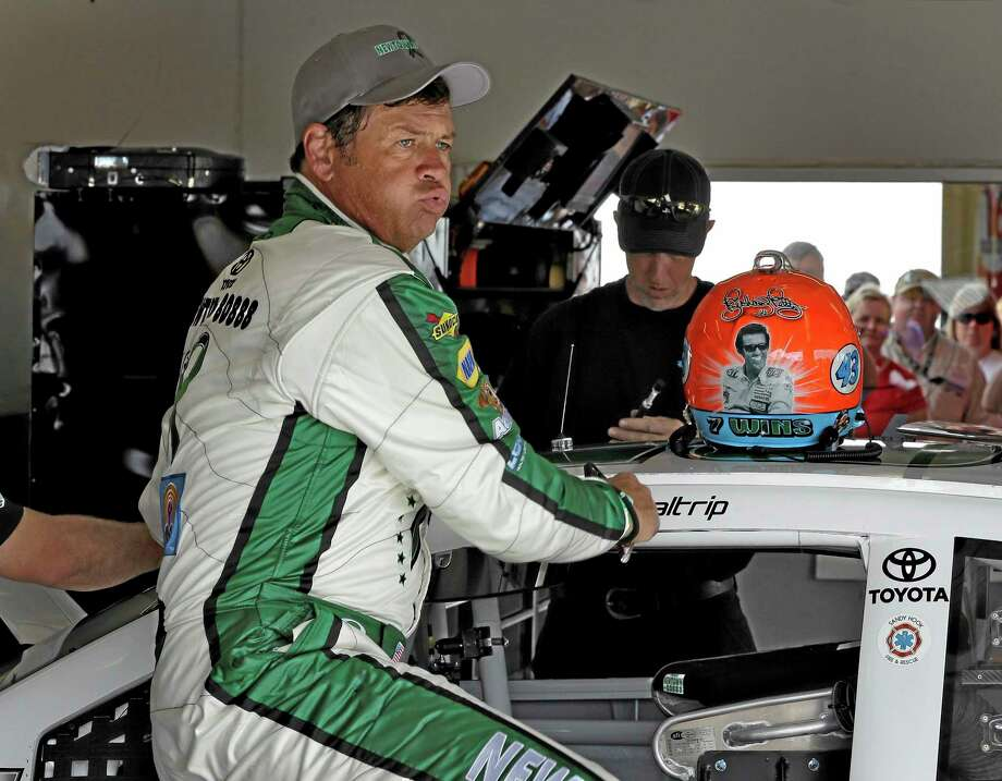 In this Feb. 23 file photo,Michael Waltrip gets out of his car during practice for the Daytona 500. Photo: Chris O'Meara — The Associated Press  / AP