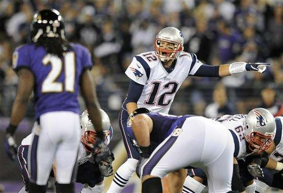 FILE - In this Sept. 23, 2012 file photo, New England Patriots quarterback Tom Brady (12) points across the line of scrimmage in the first half of an NFL football game against the Baltimore Ravens in Baltimore. Brady's passing rating is lower against the Ravens than against any other team. The Ravens and Patriots meet in the AFC Championship game on Sunday, Jan. 20, 2013. (AP Photo/Nick Wass, File) Photo: ASSOCIATED PRESS / A2012