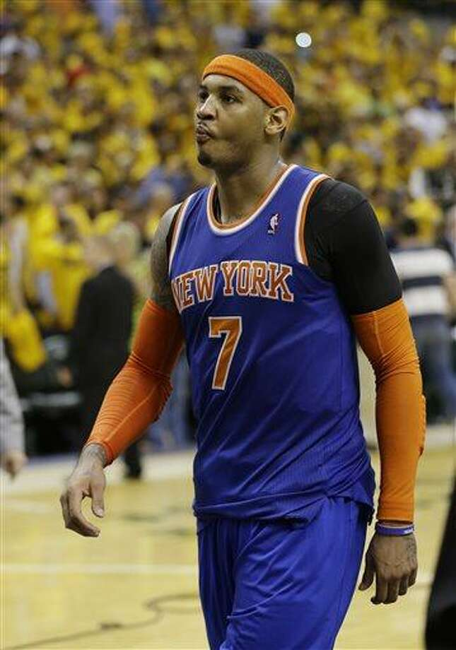 New York Knicks' Carmelo Anthony walks offcourt after the Indiana Pacers defeated New York 106-99 in Game 6 of an Eastern Conference semifinal NBA basketball playoff series on Saturday, May 18, 2013, in Indianapolis. Indiana won the series 4-2. (AP Photo/Darron Cummings) Photo: AP / AP